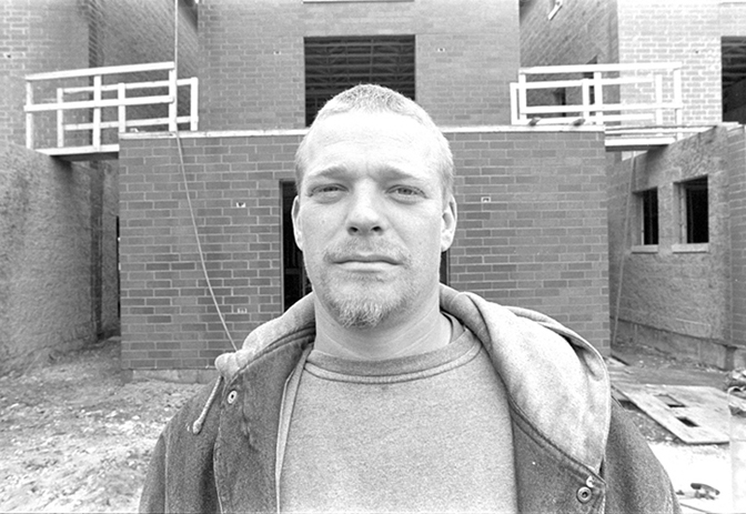 Jason Reblando, Phil Johnston, Brickwasher at new buildings on former site of Cabrini-Green, Chicago, 2002.